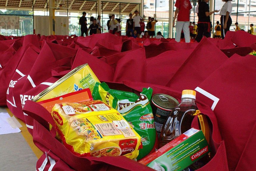 Festive packs containing Deepavali goodies, as well as household essentials such as cooking oil and toothpaste, were distributed by volunteers to some 750 needy families across Singapore.