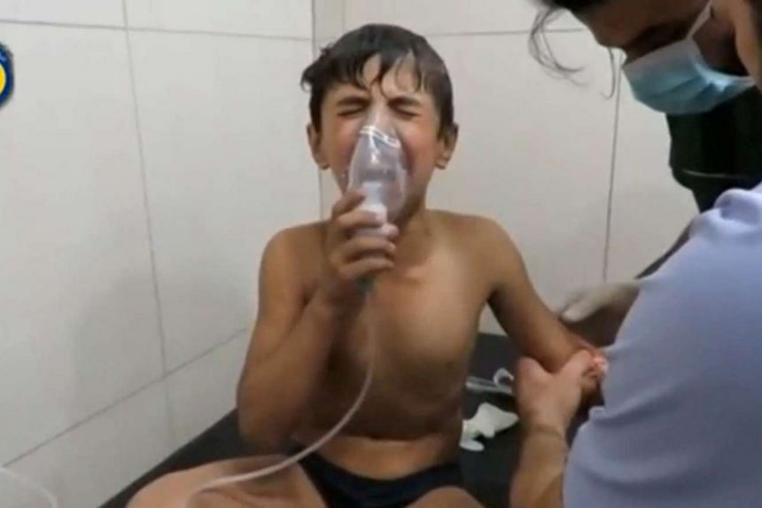 A boy breathing with an oxygen mask inside a hospital, after a suspected chlorine gas attack in Syria.