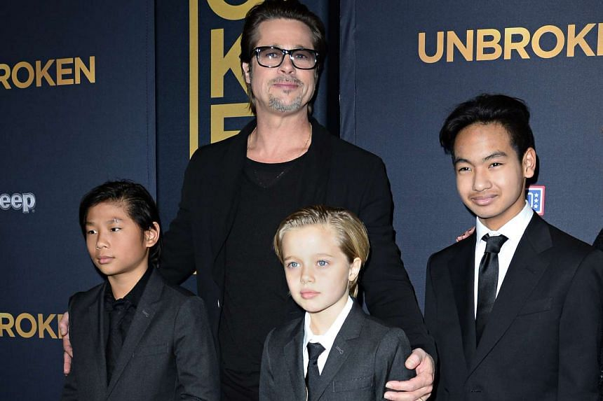 This file photo taken on December 15, 2014 shows actor Brad Pitt and children Pax Jolie-Pitt (left), Shiloh Jolie-Pitt (centre) and Maddox Jolie-Pitt as they arrive for the US premiere of Universal Pictures Unbroken, at the Dolby Theatre in Hollywood
