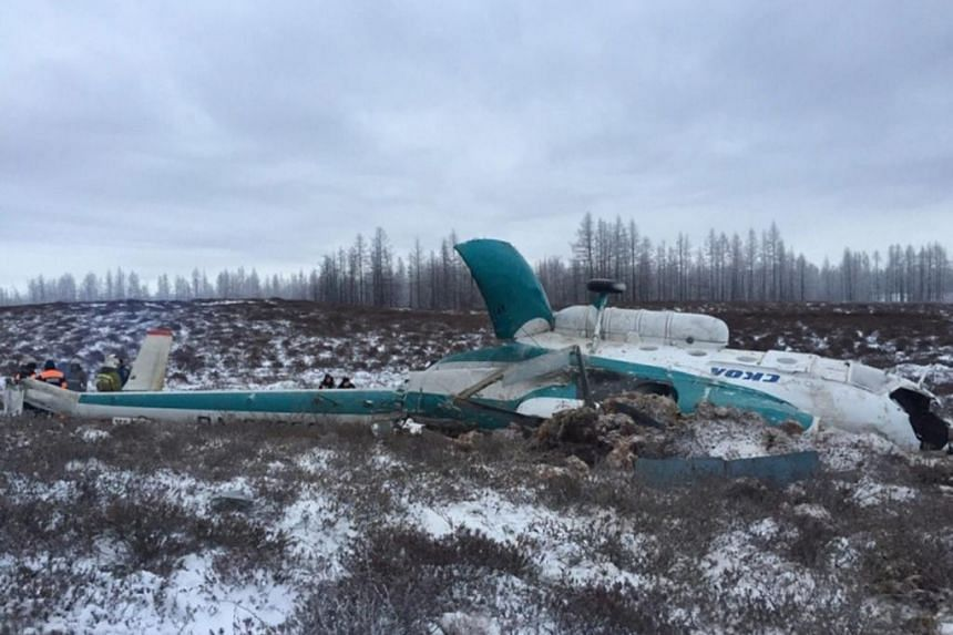 A handout picture made available by the press service of the Yamal-Nenets regional branch of the Russian Emergency Ministry on Oct 22 shows rescuers working at the site of the crash.