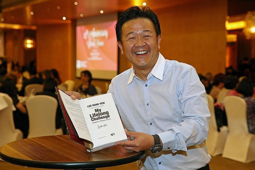 Mr Kwee's winning bid of $11,000 got him a signed copy of Mr Lee Kuan Yew's book My Lifelong Challenge at yesterday's auction.