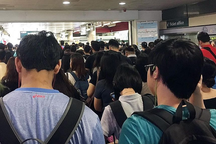 Commuters at Lakeside MRT station during the delay, which was reported at about 7am yesterday.