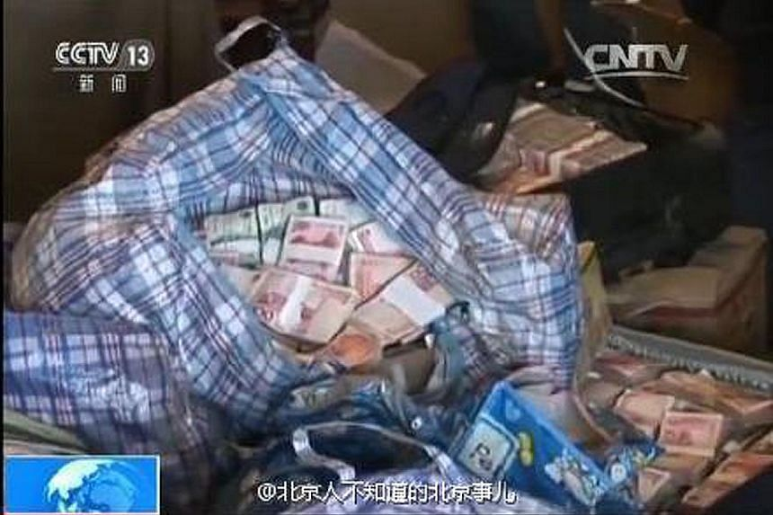 Wei Pengyuan in court during his corruption trial, and some of the cash found stashed in his Beijing apartment, as shown on state television.