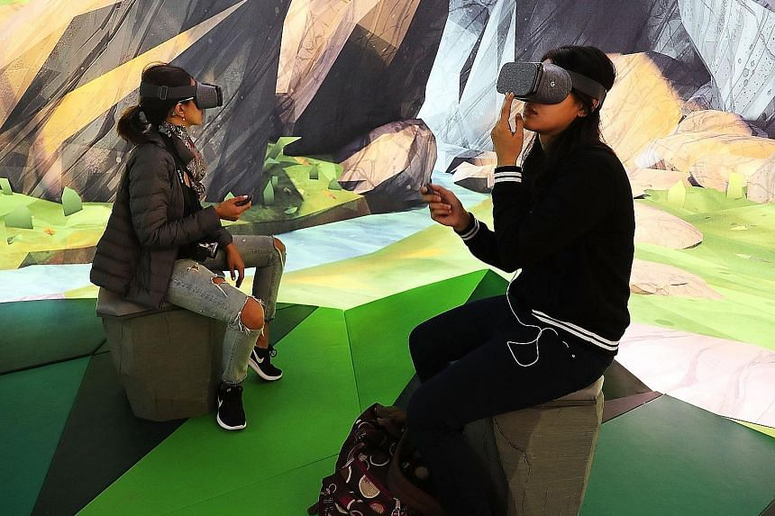 Visitors to the Google pop-up shop in New York trying out the company's new Daydream View virtual reality headset. Nothing is sold at the shop, but it allows people to get their hands on new Google devices such as the Pixel smartphone, the Home virtu