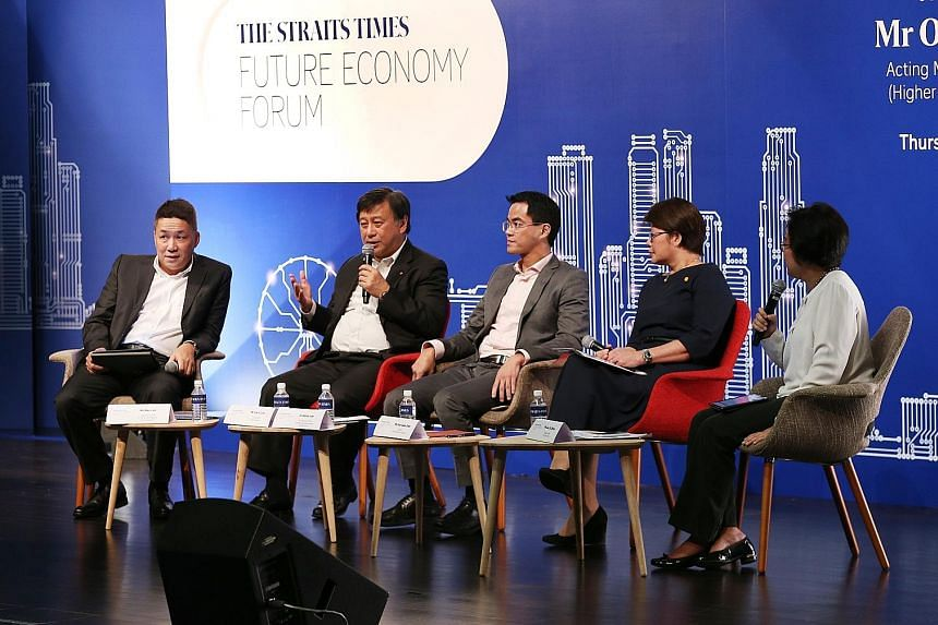 Panel members at Thursday's forum were (from left) EY's Mr Loh, DBS Singapore's Mr Sim, Parkway Pantai's Dr Loh, and Shell Singapore's Ms Goh. The moderator was ST's Ms Lee (right).
