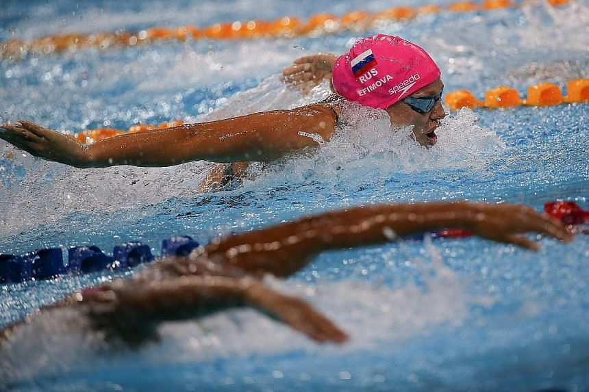 Russia's Yulia Efimova competing in the 200m individual medley. She was third behind two Hungarians, winner Katinka Hosszu and Zsuzsanna Jakabos.