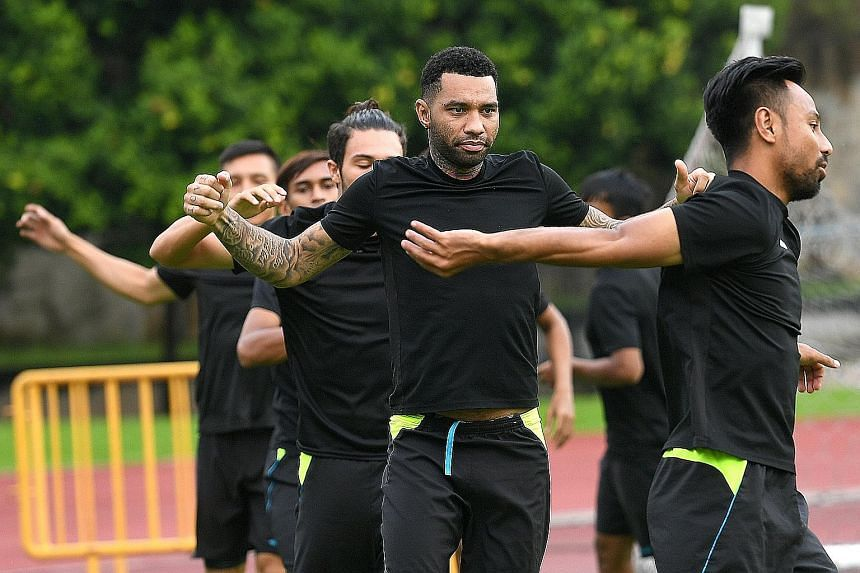 Tampines players including Jermaine Pennant (second front right) training at Jurong West Stadium ahead of tonight's S-League game against Balestier. Both sets of players will be playing for their futures.