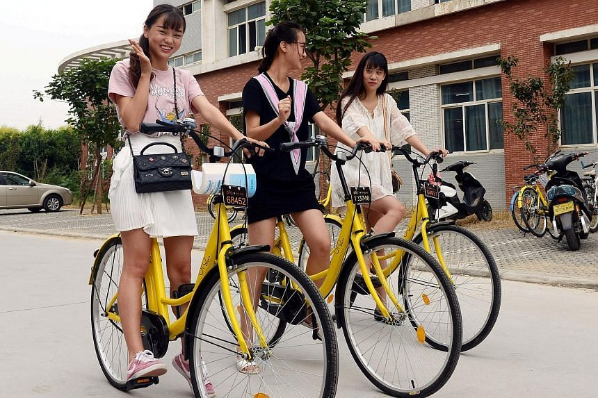 Students using ofo bicycles in Zhengzhou, Henan province. They pay one yuan (20 Singapore cents) per hour for rental. MoBike, on the other hand, charges one yuan for half an hour.