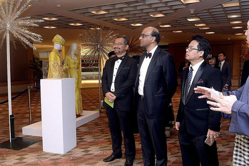 (From left) SMCCI president Zahidi Abdul Rahman, Mr Tharman, gala dinner and awards chairman Abdul Rohim Sarip and wedding entrepreneurs cluster chairman Aziz Mohammad were at the charity gala dinner held by the Singapore Malay Chamber of Commerce an