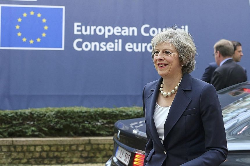 """Mrs May at the EU summit in Brussels on Thursday. She had told reporters she was there with a very clear message: """"The UK's leaving the EU."""""""