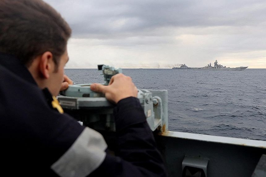 A Royal Navy lookout on the HMS Richmond observing the Russian naval task force on Wednesday in this photograph issued by the British Ministry of Defence. A Royal Navy spokesman described it as the biggest deployment of Russian naval assets seen off