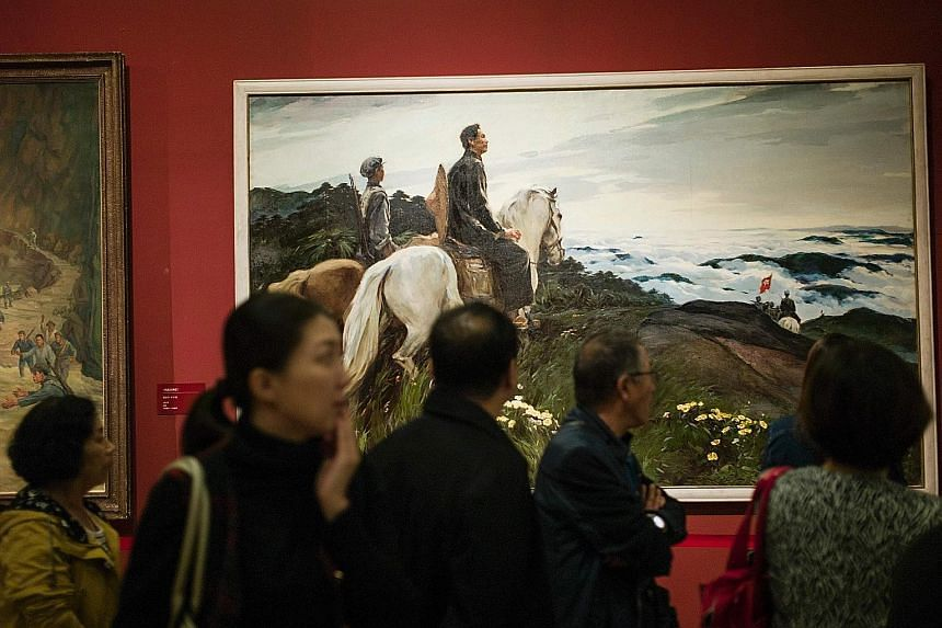 Visitors at the National Museum in Beijing on Oct 12, during an exhibition to mark the 80th anniversary of the Red Army's Long March. According to Communist Party lore, tens of thousands of marchers including Mao Zedong travelled 12,500km through rem