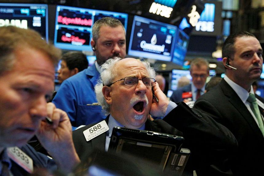 Traders work on the floor of the New York Stock Exchange, Oct 21, 2016.