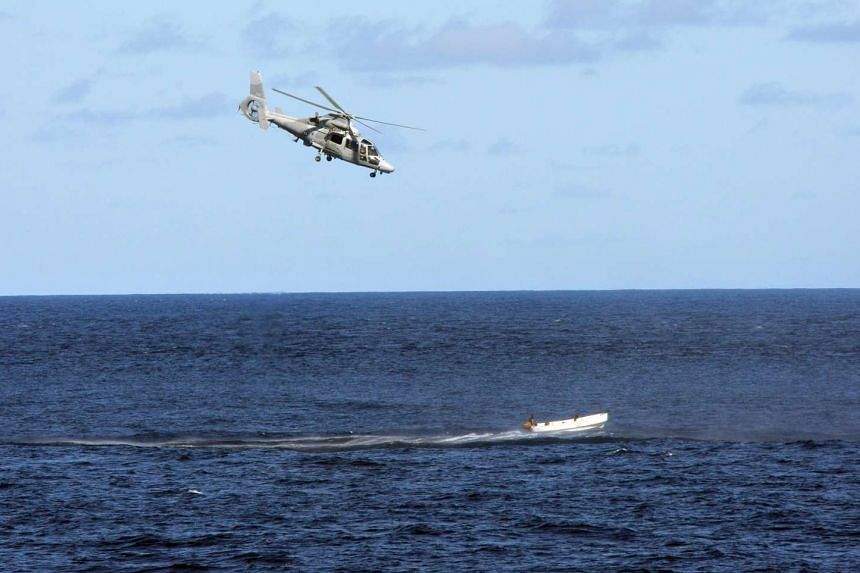 """A file photo showing a French Navy """"Panther"""" helicopter chasing a boat carrying suspected Somali pirates."""
