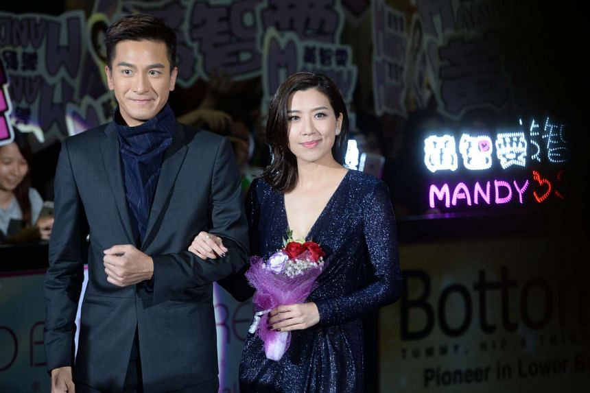 Hong Kong actress Mandy Wong (right) and actor Kenneth Ma (left) walk down the red carpet at the StarHub TVB Awards 2016.