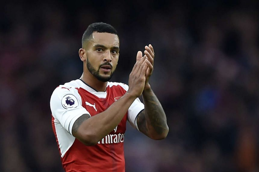 Arsenal's Theo Walcott applauds fans after the game.