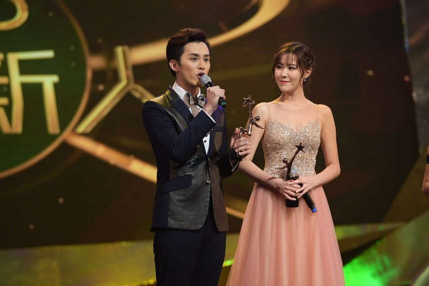 Best New TVB Artiste winners Matthew Ho and Moon Lau accept their awards at the Starhub TVB Awards 2016 on Oct 22, 2016.