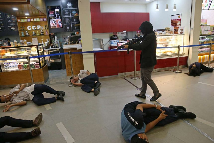 Simulated terrorists shoot civilians at Ng Teng Fong General Hospital, in the third and final installment of Exercise Heartbeat 2016 on Oct 23, 2016.