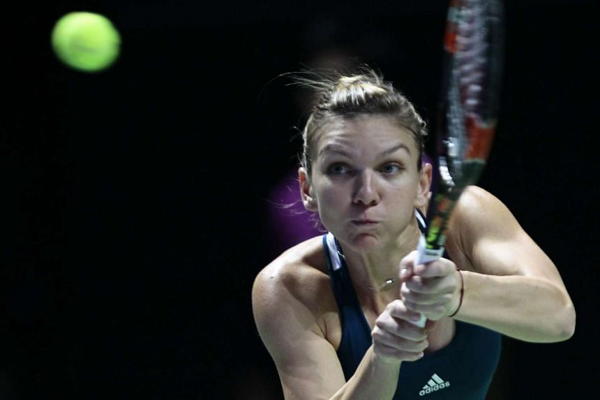 Simona Halep returning a shot against Madison Keys during their WTA Finals match in Singapore on Oct 23, 2016.