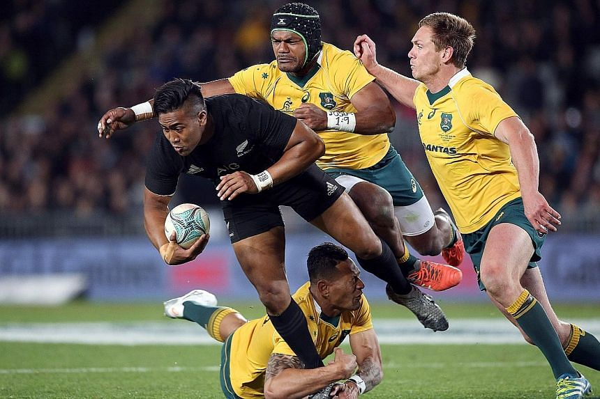 All Black Julian Savea being tackled by Australia's Henry Speight (centre), Bernard Foley (right) and Israel Folau during the third Bledisloe Cup Test at Eden Park. New Zealand won the trans-Tasman clash 37-10.