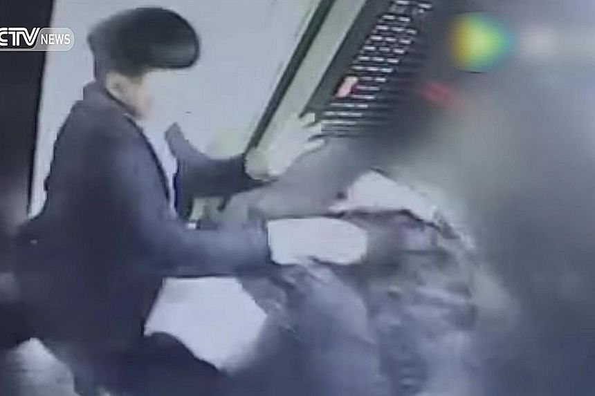 In this CCTV video screengrab of the scene inside the elevator of an apartment building, the man is seen attacking the woman. She said she had asked him to put out his cigarette and smoke in the hallway instead.