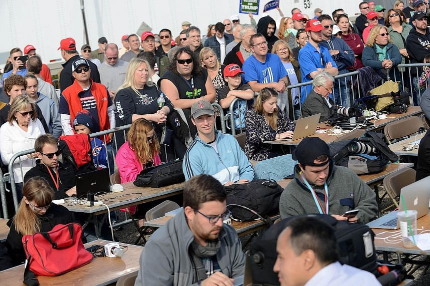 Trump supporters surrounding the media pen at a rally in New Hampshire this month. In seeking to explain Mr Trump's appeal, proportionate media coverage would require more stories about the racism and misogyny among white Trump supporters in tony sub