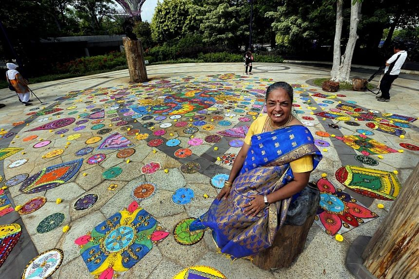 This floor decoration yesterday set a Singapore record for the largest collage made of glass marbles - 15,000 in total. Known as a rangoli, the 10m by 12m artwork at Gardens by the Bay was created by 57-year-old local visual artist Vijaya Mohan, with
