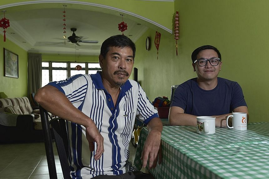 Mr Soh Chun Wee (right) is proud that his father, Mr Soh Chin Soon's (left) Western food stall has helped to put him and his younger brother through university.