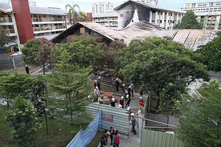 A fire engulfed a wet market and coffee shop at Block 493 in Jurong West on Oct 11, razing the building to the ground. Fifty-one stallholders have been affected by the incident.