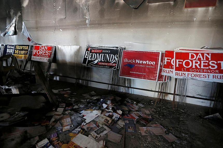 The damage caused by a firebomb attack on the offices of the North Carolina Republican Party earlier this month. The number of hate groups, some espousing violence, and armed militias in the US is rising.