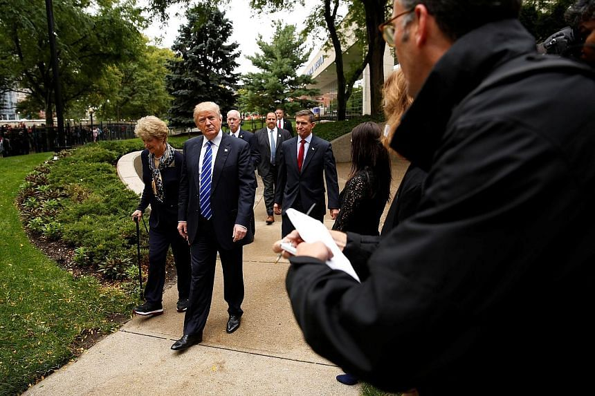 Reporters covering the Trump campaign hovering on the sidelines as the Republican candidate visited the grave of former US president Gerald Ford and his wife, Betty Ford, at the Ford Presidential Museum in Grand Rapids, Michigan, last month. One adva