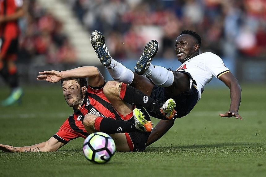 Bournemouth's Harry Arter (left) clashing with Tottenham's Victor Wanyama during their English Premier League fixture yesterday. The match ended in a frustrating 0-0 stalemate and Spurs players Erik Lamela and Moussa Sissoko were lucky not to be sent