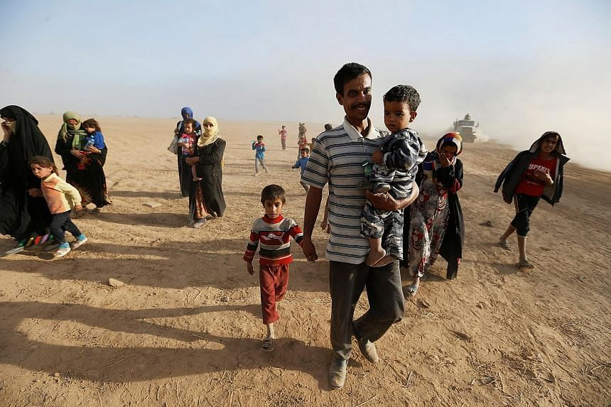Civilians returning to their village south of Mosul on Friday after it was liberated from ISIS militants. Residents still in Mosul reported that the streets are mostly empty, with ISIS fighters having either fled or moved to the front lines to defend