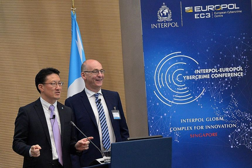 Mr Nakatani and Mr Wilson opening the Fourth Interpol-Europol Cybercrime Conference, held at the Interpol Global Complex for Innovation last month.