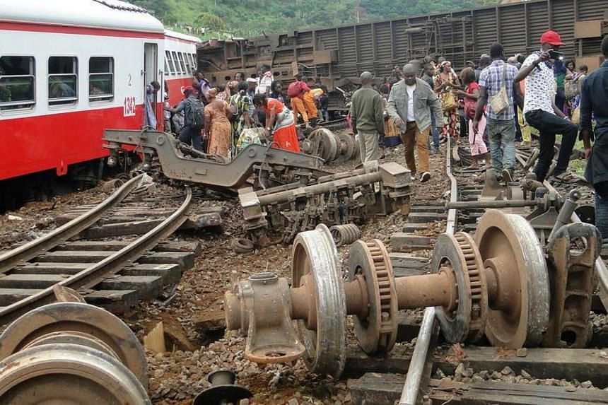 Passengers escape the site of a train derailment in Eseka on Oct 21, 2016.