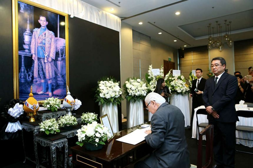 President Tony Tan Keng Yam signing the condolence book for the late Thai King Bhumibol Adulyadej at the Royal Thai Embassy in Singapore on Oct 15, 2016.