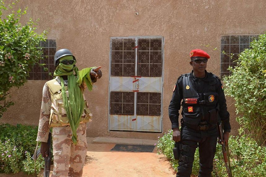 Two members of Niger's security forces standing guard outside the home of an US aid worker, Jeffery Woodke, who was kidnapped on Oct 14 by armed men in Abalak.