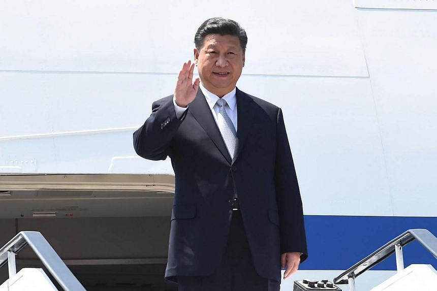 Chinese President, Xi Jinping gestures on his arrival at the airport in Goa on Oct 15, 2016.
