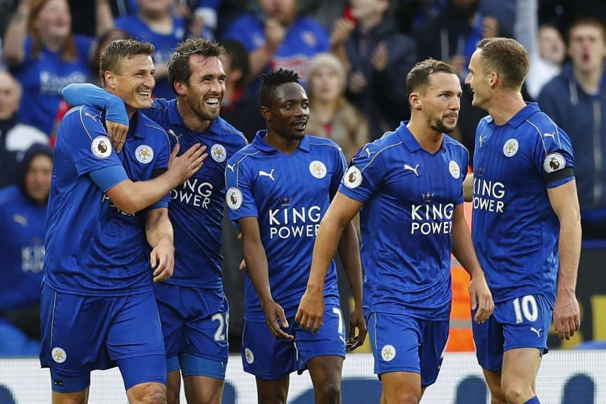 Leicester City's Christian Fuchs celebrates scoring their third goal with teammates.