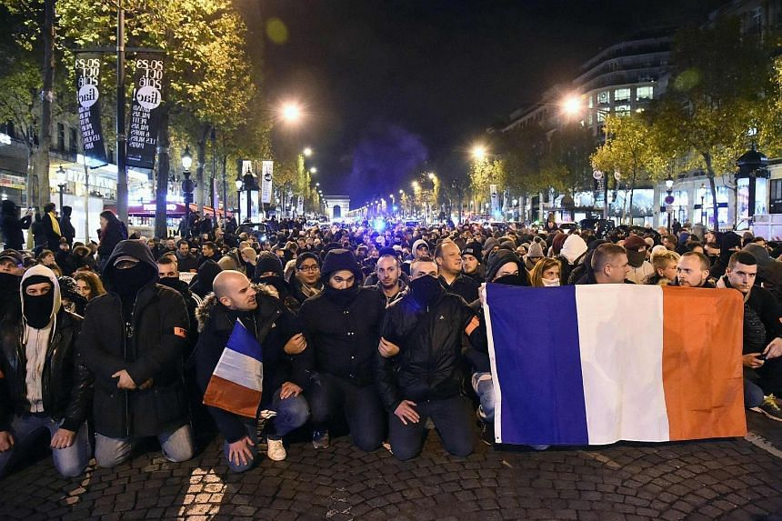 French police officers take part in a rally to protest over mounting attacks on officers in Paris on Oct 20, 2016.