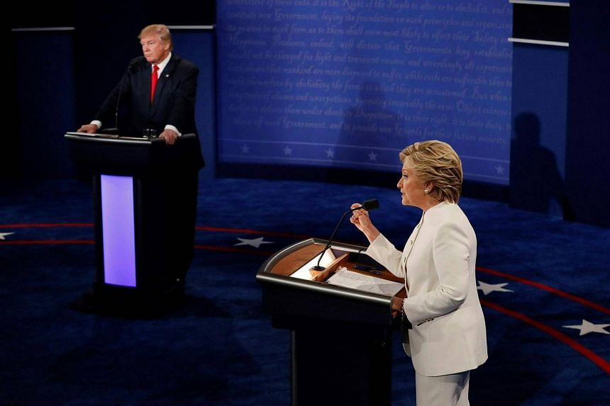 Democratic presidential nominee Hillary Clinton speaks as Republican presidential nominee Donald Trump looks on during the final presidential debate on Oct 19, 2016.