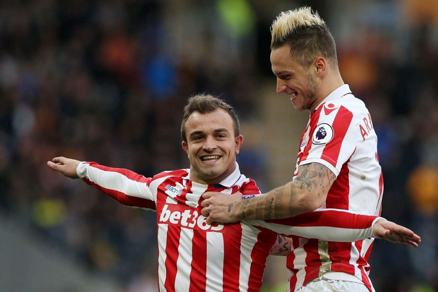Stoke City's Xherdan Shaqiri celebrates scoring their second goal with Marko Arnautovic.