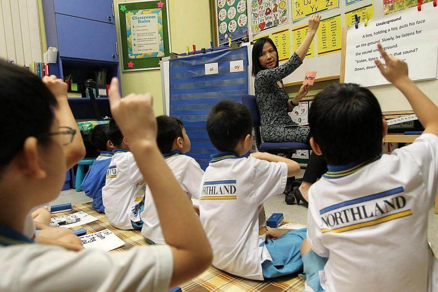 Northland Primary English teacher Tan Lee Joon teaching Primary 2 pupils.