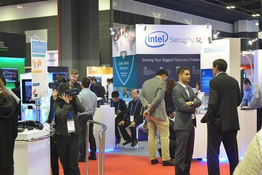 Visitors at the official opening of the inaugural Singapore International Cyber Week held at the Suntec City Convention Centre on Oct 10, 2016.