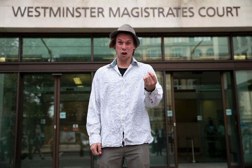 Lauri Love posing for photographers as he arrives at Westminster Magistrates Court in central London on July 25, 2016.