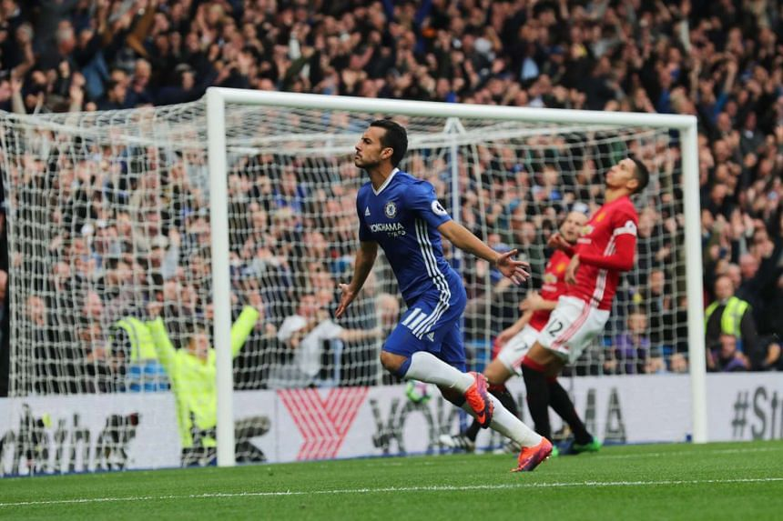 Chelsea's Pedro celebrates scoring their first goal at the Chelsea v Manchester United match at Stamford Bridge on Oct 23, 2016.