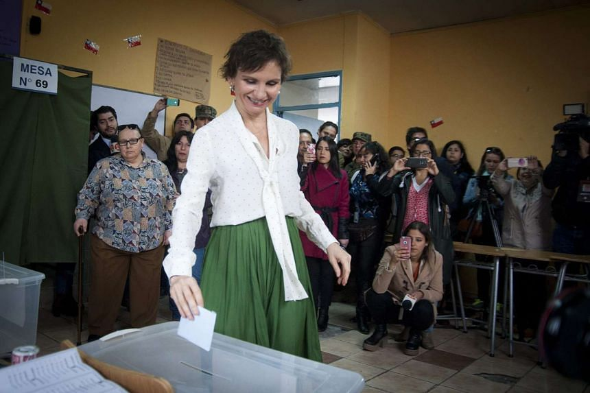 Santiago's mayor candidate Carolina Toha casts her vote in Santiago, Chile, on Oct 23, 2016.