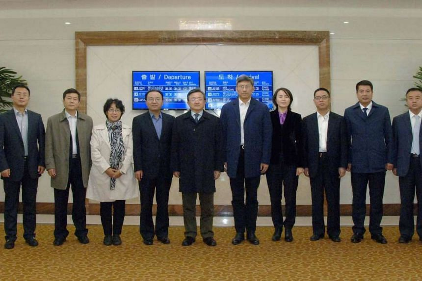 Chinese Vice-Foreign Minister Liu Zhenmin (5th from left) posing for a photo with his delegates upon arriving in Pyongyang, in this undated photo released by North Korea's Korean Central News Agency (KCNA) Oct 24, 2016.