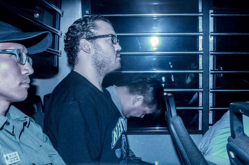 British banker Rurik Jutting (second left) being taken in a prison van to the Eastern Court in Hong Kong on May 8, 2015.