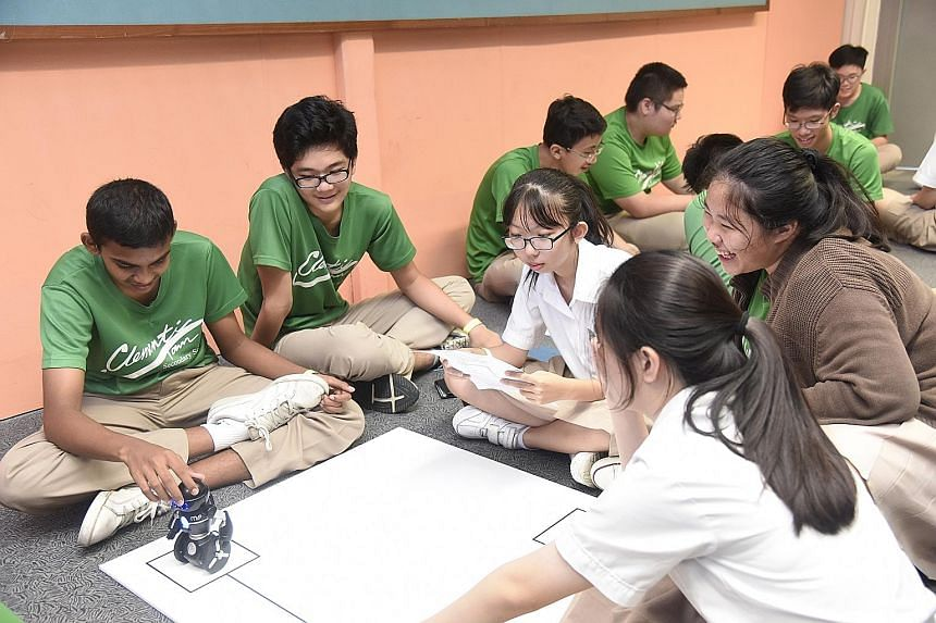 Students from Clementi Secondary School taking part in the robotics workshop, part of this year's Engineering Discovery event. Organised by the five polytechnics, this year's event included for the first time workshops for students to try out project
